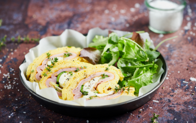 Omelette roll with zucchini and cooked ham