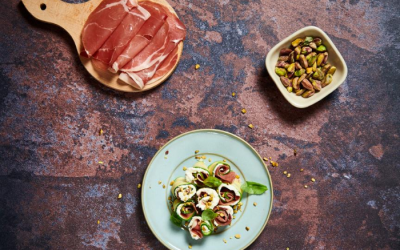 Grilled zucchini rolls with prosciutto and soft cheese