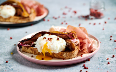Poached egg on whole wheat toast with radicchio and Italian Prosciutto