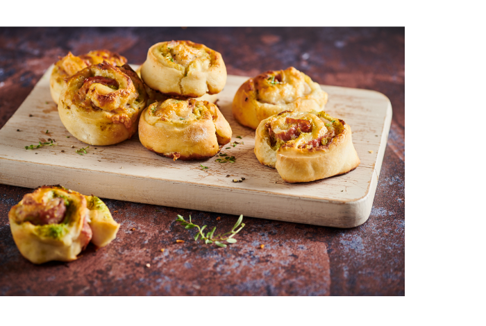 Pizza dough rolls with salame Toscano and broccoli cream